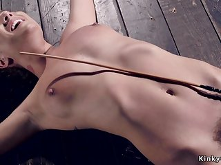 Shackled slave caned on the floor