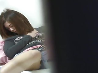 Asian teen rubs herself