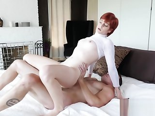 Girth redhead humping hard on her boys fat cock