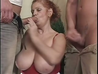 This wild granny with huge breasts deserves a garter for giving as a result much pleasure