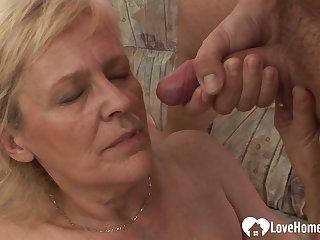Luscious fair-haired granny takes his raging boner