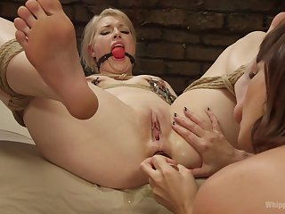 First time she gets gagged and ass fucked by a woman
