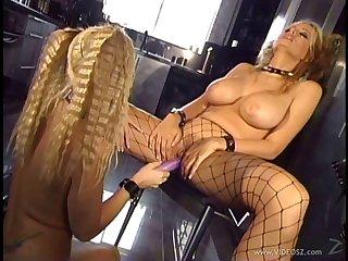 Curvy lesbian pornstar in fishnet lingerie enjoying a hot anal toying session