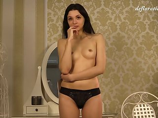 Shy Russian incomprehensible Alesya Razorvalo strips coupled with pleasures their way pussy