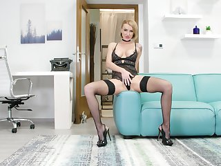 Sexually charged babe more stockings and lingerie masturbates pussy
