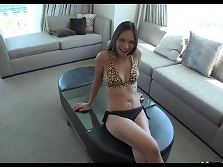 An amateur, Asian woman is having sex in a hotel room with a filthy rich supplicant